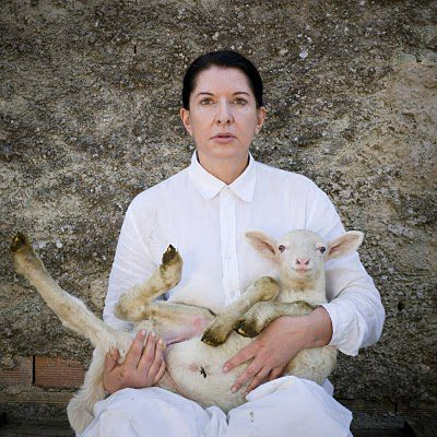 Portrait with white lamb_ 2010_ Courtesy Marco Anelli  and  Marina Abramovic
