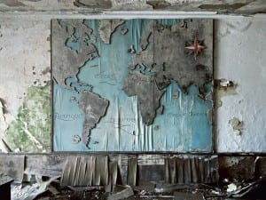 Reginald Van de Velde, World Tours, Not Wars, 2010. Belgium. A wooden world map is slowly rotting away inside the director's office of a closed down factory.